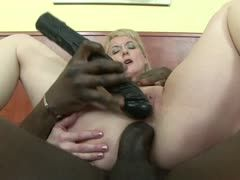 Milf is penetrated by a black cock and a huge dildo