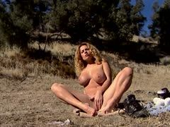 Slut poses outdoor